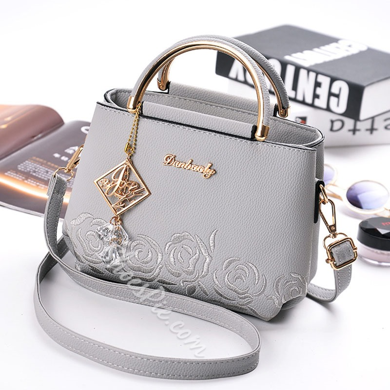 Shoespie Exquisite Pendant Embossing Handbag